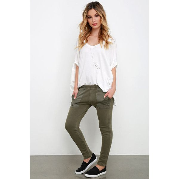 Obey Berlin Olive Green Jogger Pants ($89) ❤ liked on Polyvore featuring pants, green, white jogger pants, green camo pants, white elastic waist pants, jogging trousers and green jogging pants
