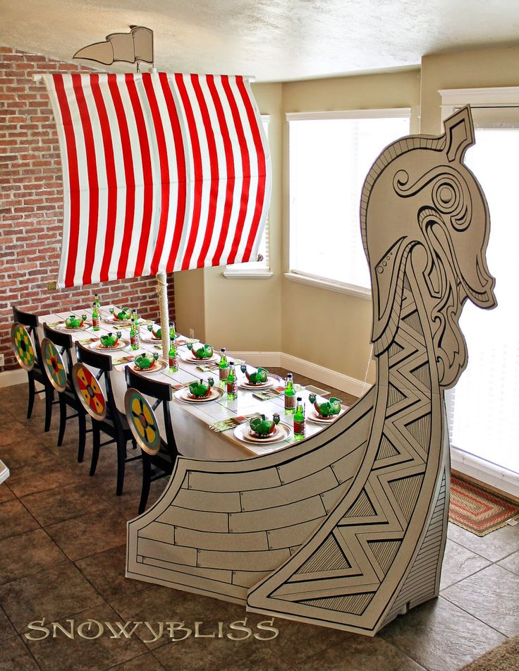 Viking and Dragon Party...I always love her party centerpieces, how AMAZING is this table?