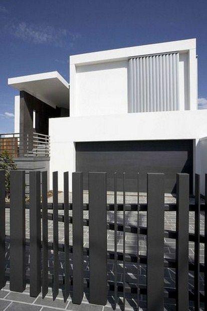 Fachadas de casas con rejas verticales modernas Rejas