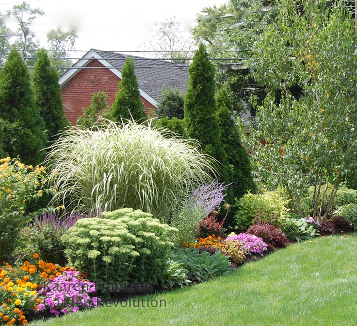 Beautiful landscaped border...privacY and beauty.  Low medium, and tall in drifts of color and texture.