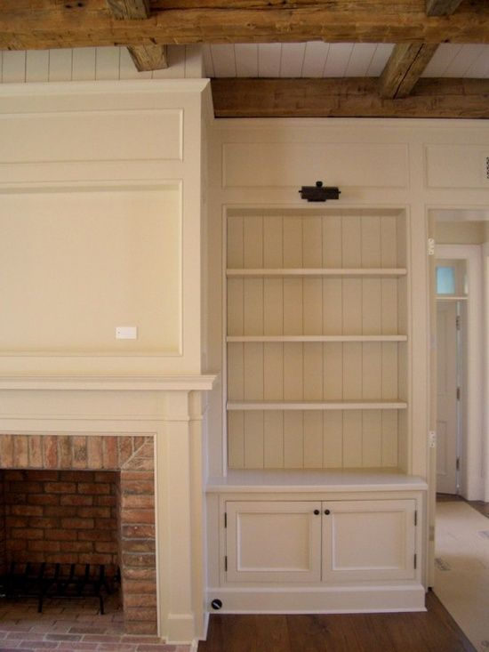 built in bookshelves for around fireplace. i love ceiling beams and wainscoting beadboard...