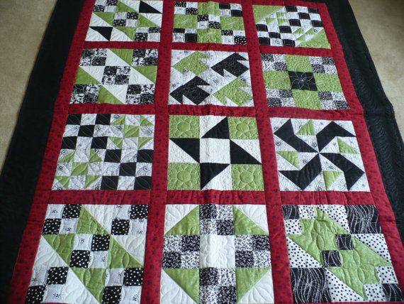 Jazzy is a Lap Quilt Sampler, showing different quilt blocks with custom quilting, in green black white and red.