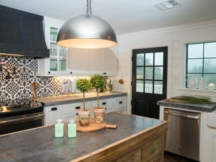 The island and light fixture in the second story kitchen of the Meek home, as seen on Fixer Upper. (after)