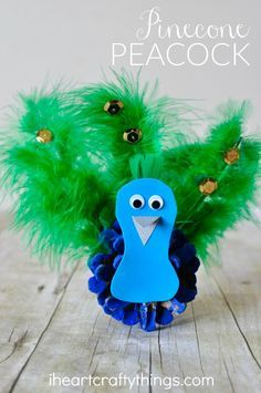 This pinecone peacock craft is great for any time of the year, especially after learning about birds or visiting your local zoo or aviary. Fun bird craft, preschool craft, summer kids craft, and pine cone craft.