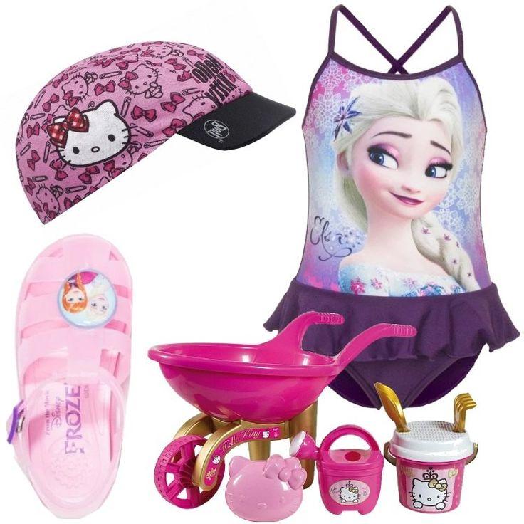 Costume intero con balze e spalline incrociate sulla schiena. Sandaletti rosa di Frozen come il costume. Cappellino in tela con visiera di Hello Kitty. Anche il set di giochi da mare è firmato Hello Kitty: carriola, secchiello, rastrello, paletta, annaffiatoio e stampino.