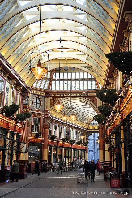 Leadenhall Market, London. A covered market in the City of London, located in Gracechurch Street.  The ornate roof structure was designed in 1881 by Sir Horace Jones.   More recently its been used to represent The Leaky Cauldron and Diagon  Alley in the film Harry Potter and the Philosopher's Stone.