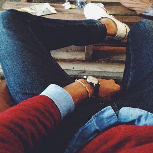 red sweater, blue shiert, jeans, white shoes