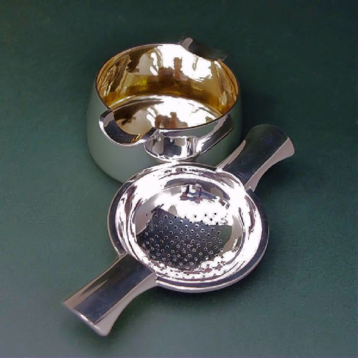 Silver tea strainer polished finish