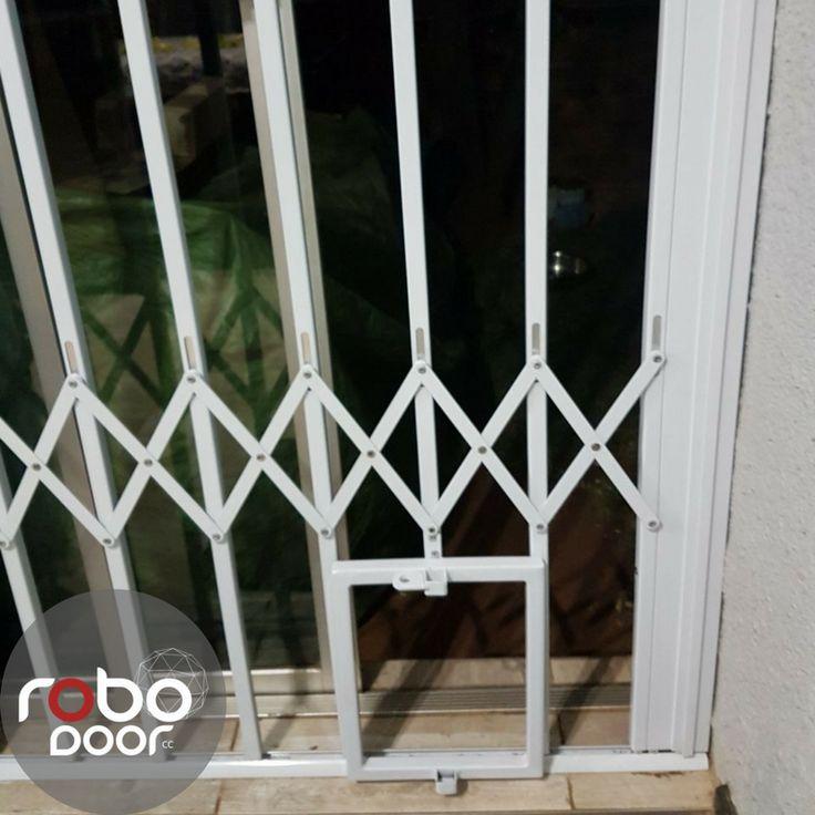 Robo Door let's the dogs out. Get your custom made pet friendly trellis door.