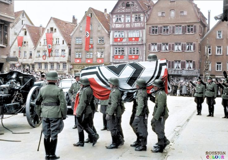 Generalfeldmarschall Erwin Rommel's funeral ceremony held in his hometown of Ulm (Württemberg), Mid-day on Wednesday 18 October 1944. The casket was placed on the tail of a light howitzer cannon 10.5 cm leFH (leichte FeldHaubitze) 18, with his Marschallstab (Marshal's Staff) displayed on the flag draped over his coffin.