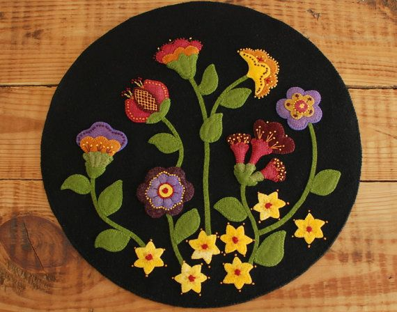 FREE First Class SHIPPING for the pattern of this gorgeous table topper, Jacobean Flowers!  Be sure to ZOOM for the details. Ive taken large photographs which youll be able to refer back to, particularly for the embellishment stitching, when working this pattern.  When I listed the original of this penny rug as a finished piece in 2012, it sold almost overnight. Not long after that, I had to abandon my Etsy shop in favor of a real job. Yet, whenever I browsed through wool applique Pinterest…