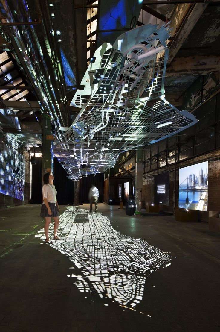 A floating replica of Manhattan's road infrastructure (1:1500 scale), an installation made of aluminum by Columbia University architecture students for the Experiments in Motion Exhibition at the Essex Street Warehouse, New York City. Photos by Collin Erickson.