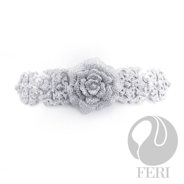 """- 0.5 micron natural rhodium plating - Set with thousands of AAA white cubic zirconia - Dimension: 13.5"""" x 2""""  Part of the FERI Bridal Lines. Glamorize your wedding dress on your special day with FERI special bridal jewelry. Matching earrings and bracelet are also available.  Invest with confidence in FERI Designer Lines."""