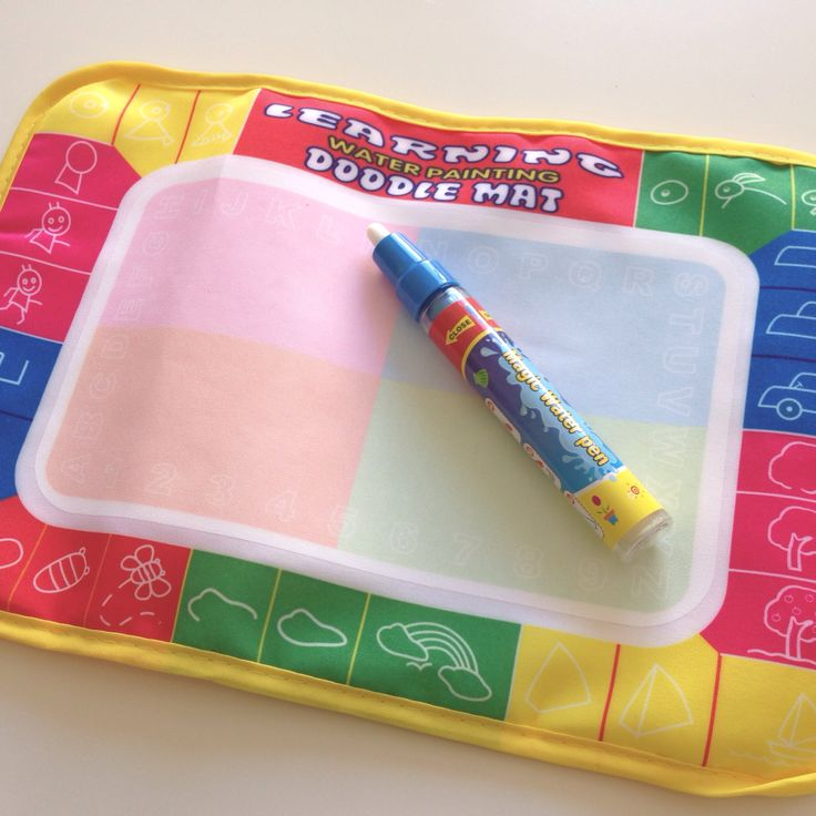 Doodle mat with pen. Magic doodle mat fill pen with water and draw. Great for toddlers ..