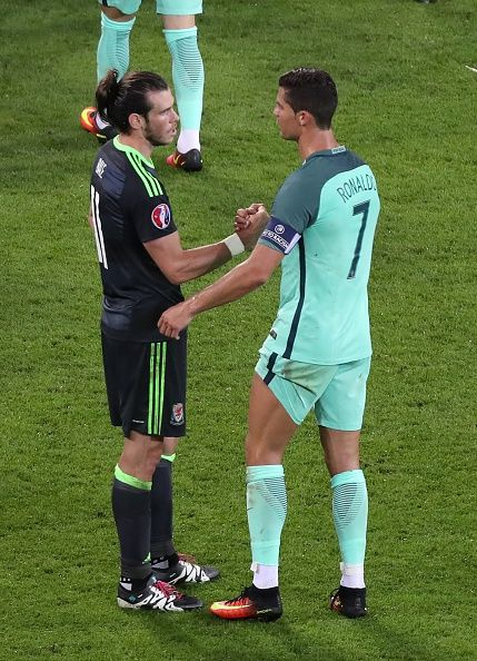 #EURO2016 Cristiano Ronaldo of Portugal speaks with Gareth Bale of Wales after the UEFA Euro 2016 semi final match between Portugal and Wales at Stade de Lyon...