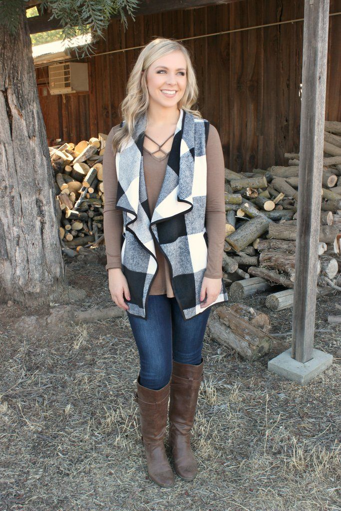 Enjoy the cooler weather with this medium weight vest in a fabulous black and white checker pattern. Draped front design with front pockets! Soft fleece fabric with a lining to match. Pair it up: Autu