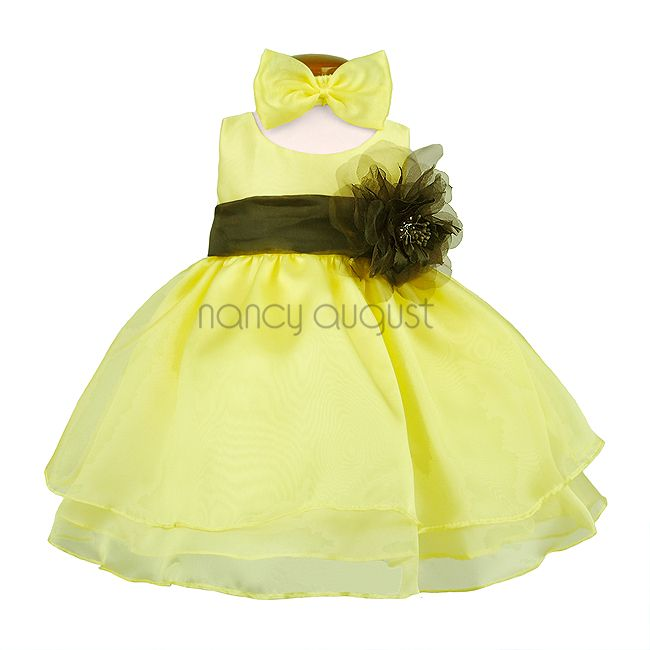 Yellow Organza Layered Baby Dress: This sassy yellow organza layered baby dress features a sensational sleeveless style with a triple layer skirt. This beautifully simple organza tea length dress comes with a a adjustable sash tie in the back. Like many of our special occasion dresses, it is versatile and can be used as a flower girl dress, pageant dress, or even as a holiday party dress.