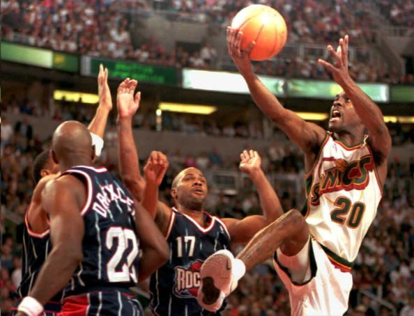 Seattle SuperSonics Gary Payton attempts to score against Houston Rockets Clyde Drexler and Mario Elie in fourth quarter action of game two of their...