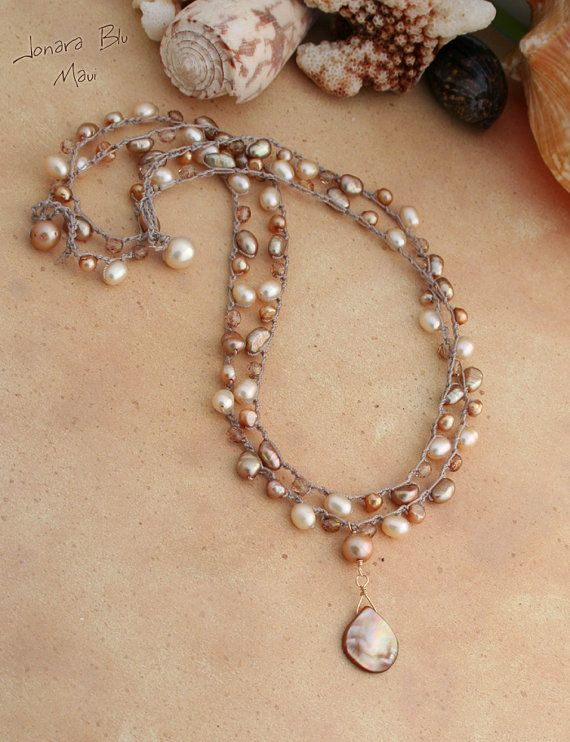 gorgeous layers of beachy boho pearls and fire polish crystal with pink shell pendant..perfect for the beach wedding. www.jonarablumauijewelry.etsy.com