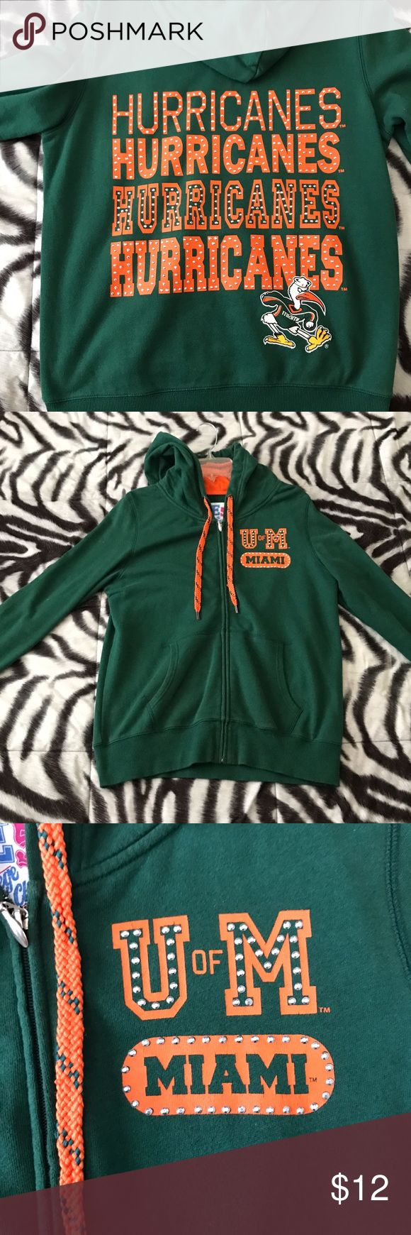 University of Miami Zip Up Sweater w/ rhinestones Womens Large, Full Zip-Up, University of Miami/UM Hurricanes, Hoodie with Exceptional Embellishing  It is in the school colors (green & orange with a touch of bling!).   80% Cotton / 20% Polyester Official Licensed Collegiate Product by 'E5 College Classics Sweaters