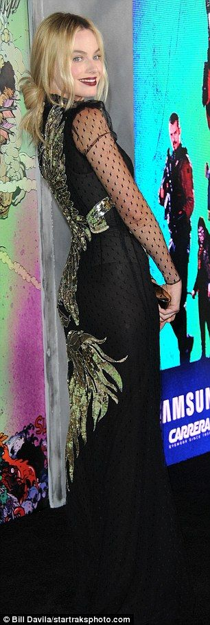 Aug. 4, 2016 - Margot Robbie wears sequined unicorn dress by Alexander McQueen to Suicide Squad premiere