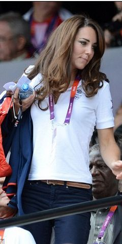 Who made Kate Middleton's white polo top, blue jeans, wedge pumps, and jacket? Jeans – J Brand  Sunglasses – Givenchy  Jacket – Team GB  Shirt – Adidas  Shoes – Stuart Weitzman