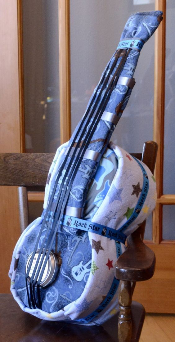 Perfect DIY gift for the musician-to-be! A Rockstar Guitar Cloth Diaper Cake! #babyshowergifts #DIYbabygifts #rocknrollbaby - cheap clothes for men, shopping online clothes cheap, clothes for fashion *ad