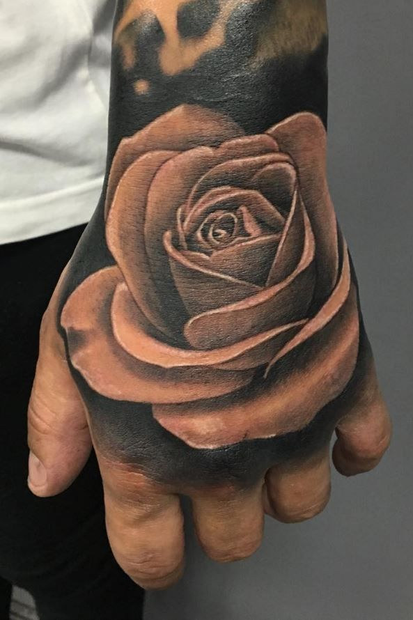 Hand Rose Tattoo Inkstylemag Rose Hand Tattoo Rose Tattoos Trendy Tattoos