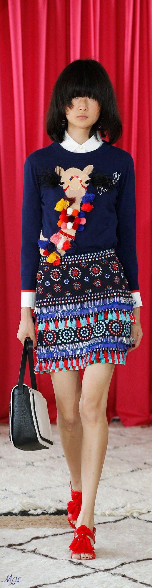 Kate Spade New York S-17 RTW: camel with pom poms jumper, ethnic skirt.