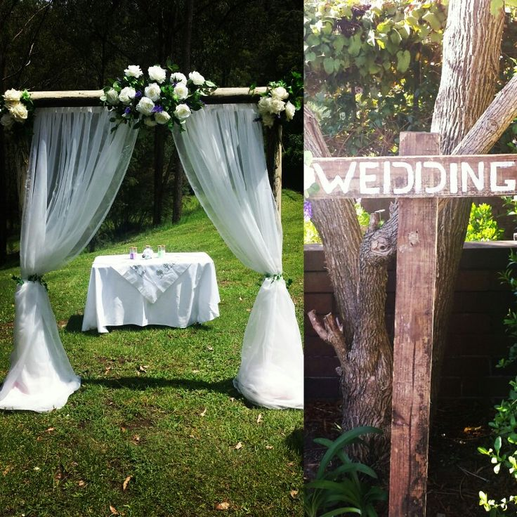 Rustic archway and rustic sign