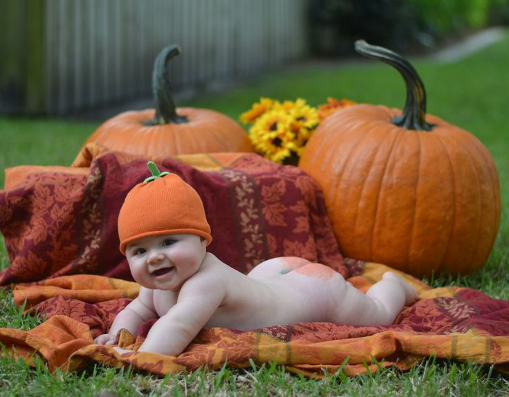 Baby butt painted like pumpkin
