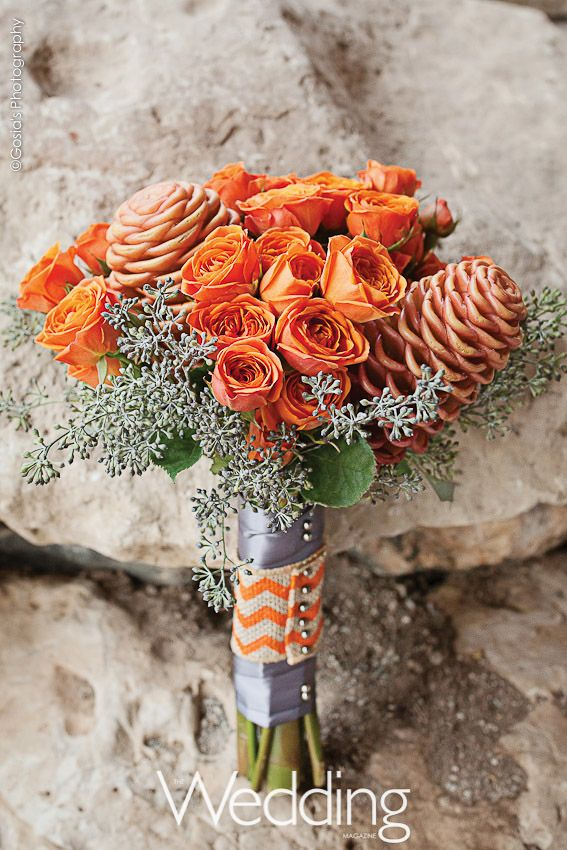 Beehive ginger, orange spray roses, gray seeded eucalyptus with satin and burlap wrap. Created by Divine Nature.