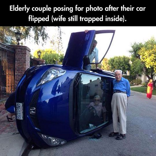 Couple Poses For Photos After Car Flips.......The idea of taking a picture and posing for it came BEFORE getting trapped old lady OUT OF THE CAR????