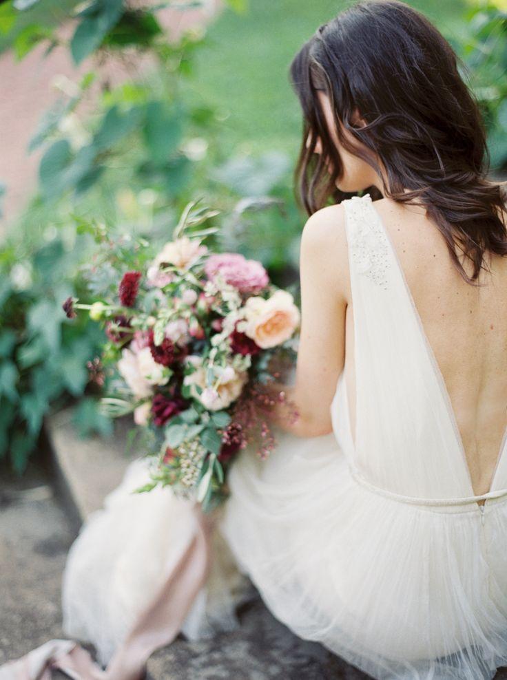 Deep V-back chiffon wedding dress: http://www.stylemepretty.com/2016/02/17/modern-wedding-dresses/