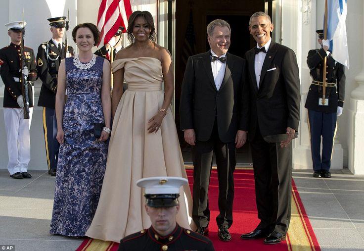 Next to arrive wereFinnish President Sauli Niinisto his wife Jenni Haukio, with the honor guard flying the U.S. and Finnish flags