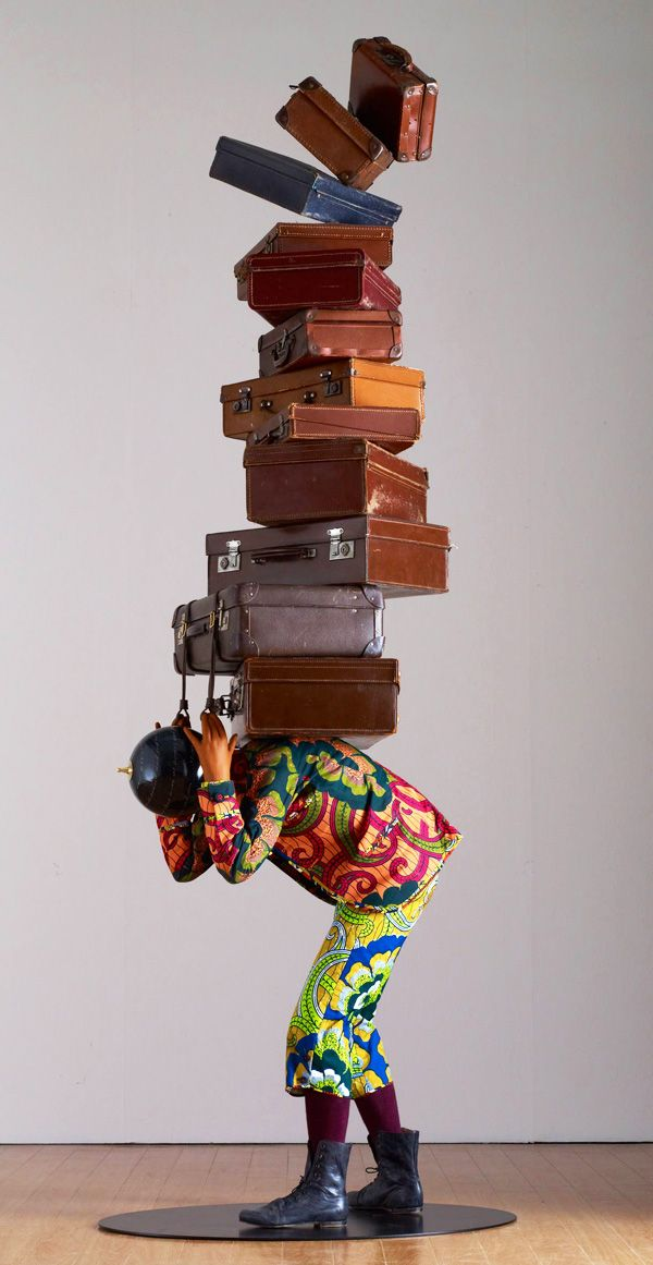 Art Basel Miami Beach: Yinka Shonibare, MBE, Homeless Boy, 2012. Mannequin, Dutch wax printed cotton textile, leather suitcases, globe, and metal base. Courtesy Stephen Friedman Gallery, London