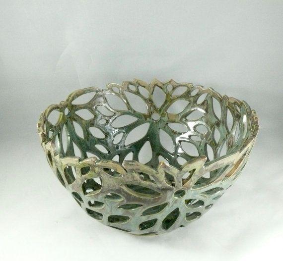 https://www.etsy.com/listing/75366226/ceramic-cut-out-art-vessel-fruit-bowl?ga_order=most_relevant