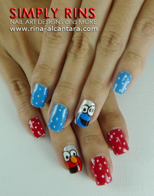 Elmo & Cookie Monster nails @Amber Michelle I will expect your nails to look like this for your nieces birthday!