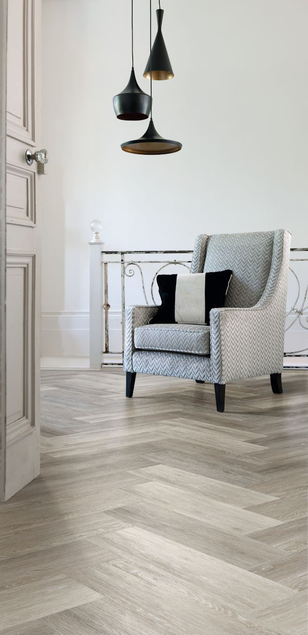 Modern herringbone parquet flooring effect created using Cavalio Conceptline luxury vinyl tiles in Limed Oak, Grey