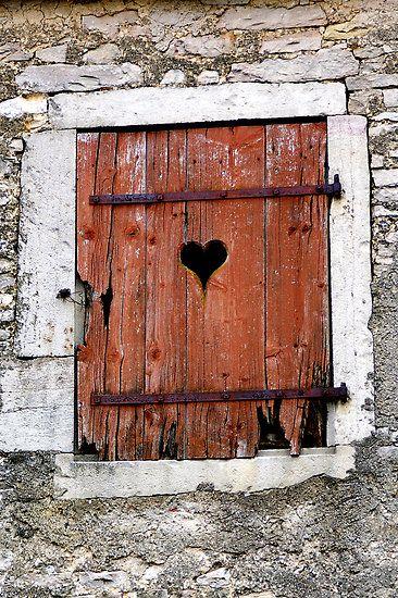 heart shape on a timeworn shutter in dijon, france - by Kane Horwill