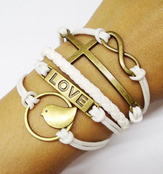 Infinity braceletsFiligree cross braceletsletter by KJkongkiet, $5.99