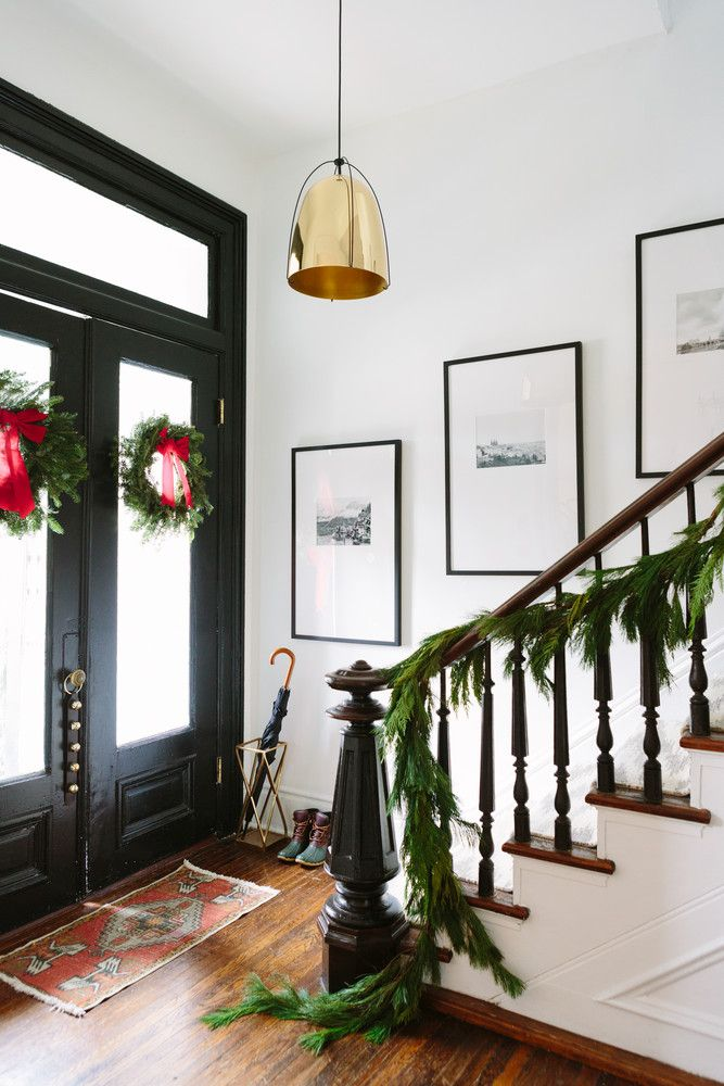 garland + wreaths = the perfect holiday decorated entryway