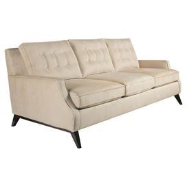 "Midcentury-inspired sofa with tufted detailing and angled legs. Made in the USA.  Product: SofaConstruction Material: Polyester and woodColor: BeigeFeatures:Angled legs8 GA sinuous spring constructionPerfect addition to any roomMade in the USA Dimensions: 36"" H x 90"" W x 39"" D Cleaning and Care: Professional dry cleaning is recommended"