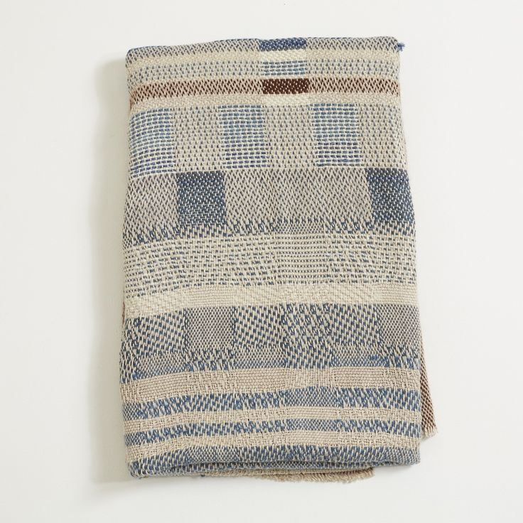Large Alpaca wool & linen throw in a varying geometric brown & indigo pattern. A one-off piece entirely handwoven by Catarina in her London studio. Edition of 1