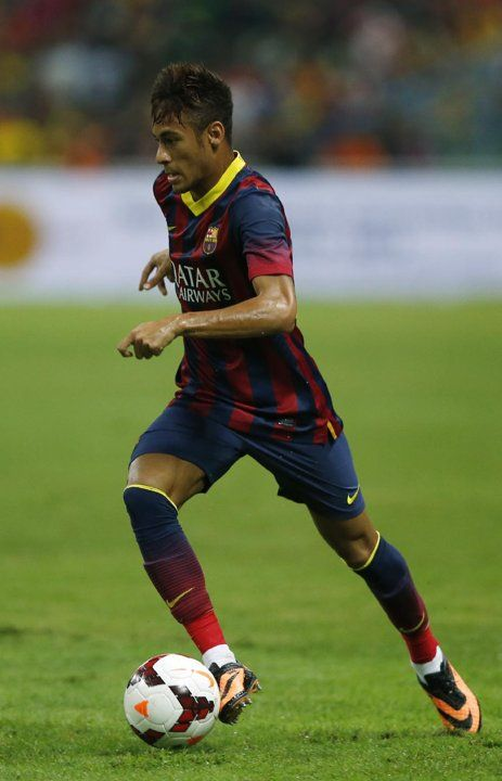 FC Barcelona's Neymar controls the ball during friendly soccer match with Malaysia XL in Shah Alam, Malaysia, Saturday, Aug. 10, 2013