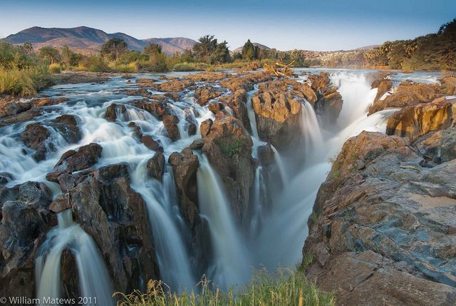 Africa | The Epupa Falls (also known as Monte Negro Falls in Angola) are created by the Kunene River on the border of Angola and Namibia, in the Kaokoland area of the Kunene Region. |  © William Matews & Guilermo Mateos.