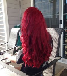 Bright red long wavy hairstyle, amazing red hair color