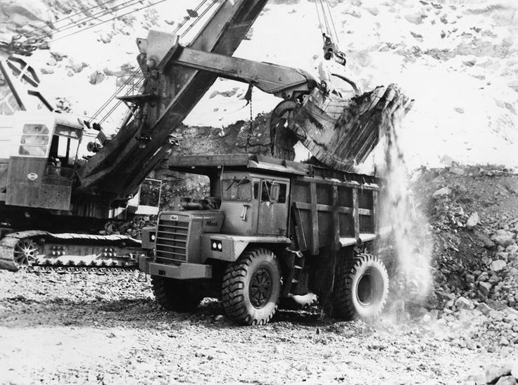 Mack Trucks An M60X Mack dump truck hard at work at a mining site in 1963. This model was the largest off-highway truck produced by Mack at that time. Only two M60X models were produced from 1962-1963.