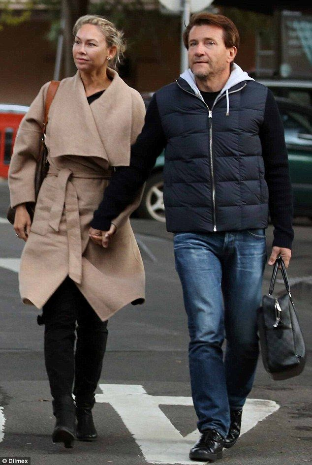 Loved up! Kym Johnson only has eyes for her billionaire beau Robert Herjavec as they jetted into Sydney on Sunday morning ahead of her latest stint on Dancing With The Stars Australia