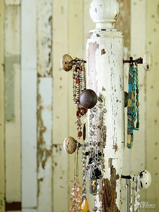 A weathered porch post and flea market doorknobs make a one-of-a-kind jewelry holder with vintage style. Fasten old-fashioned doorknobs at varying heights to provide the perfect space for necklaces and bracelets to hang.